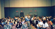 Audience lined up to share elevator speeches at Craig's 1999 Convention program in Chicago, 8-21-99